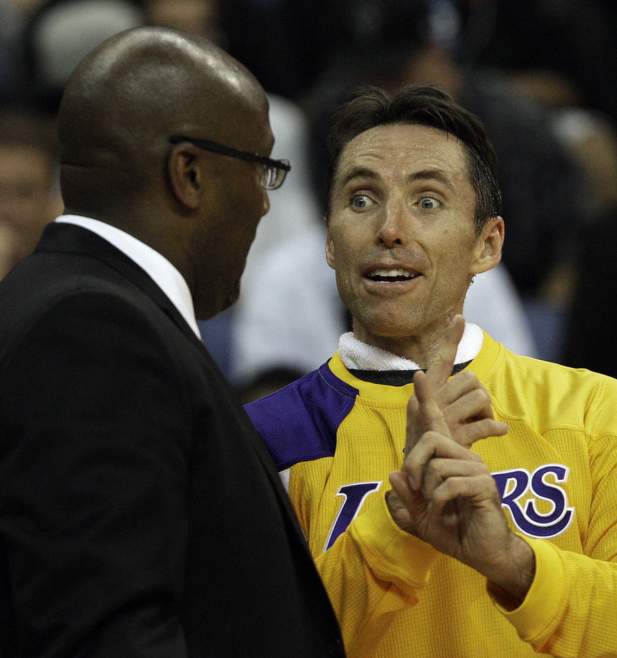 Los Angeles Lakers guard Steve Nash talks with head coach Mike Brown in the second half of a game against the Portland Trail Blazers in an NBA basketball game in Ontario, Calif., Wednesday, Oct. 10, 2012. Portland won, 93-75. (AP Photo/Reed Saxon)