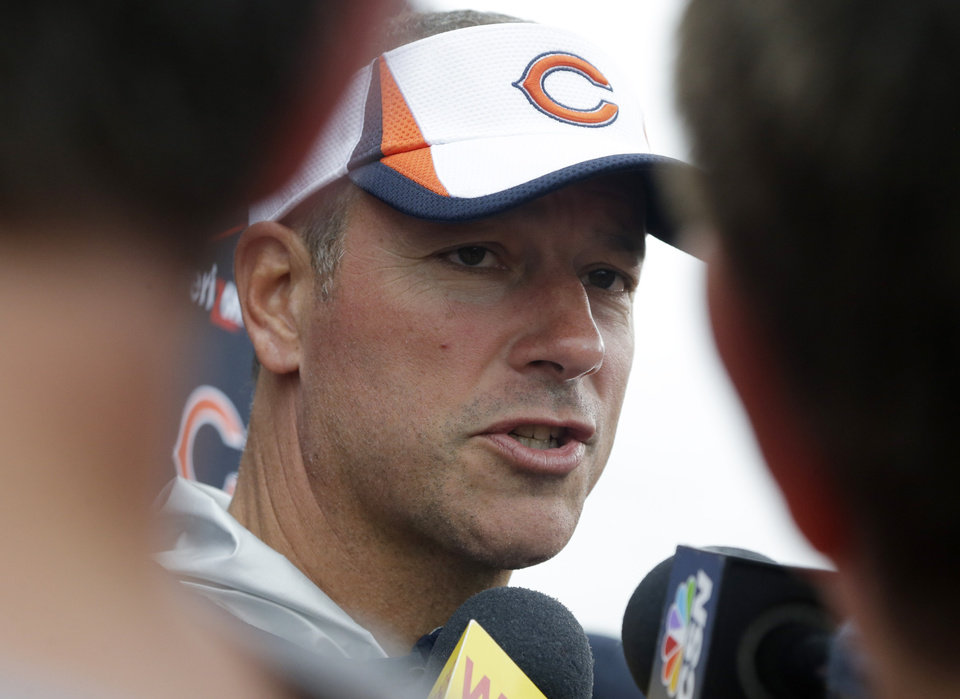 Photo - Chicago Bears Chicago Bears offensive coordinator Aaron Kromer talks to reporters after NFL football training camp Wednesday, July 31, 2013, in Bourbonnais, Ill. (AP Photo/Nam Y. Huh)