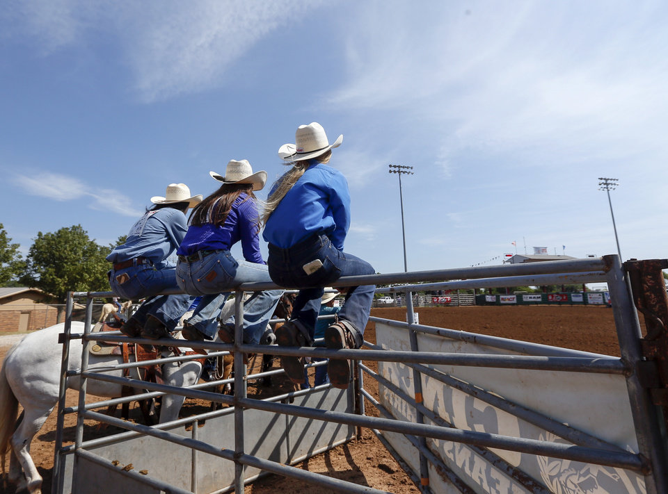 Photo - Competitors watch barrel racing during the International Finals Youth Rodeo at the Heart of Oklahoma Exposition Center in Shawnee, Okla., Thursday morning, July 11, 2019. [Nate Billings/The Oklahoman]