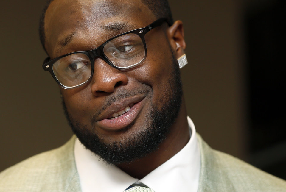 Gerald McCoy of the Tampa Bay Buccaneers gives an interview during the March of Dimes Sports Headliner Awards Banquet at the Chickasaw Bricktown Ballpark in Oklahoma City, Thursday, June 20, 2013. Photo by Nate Billings, The Oklahoman