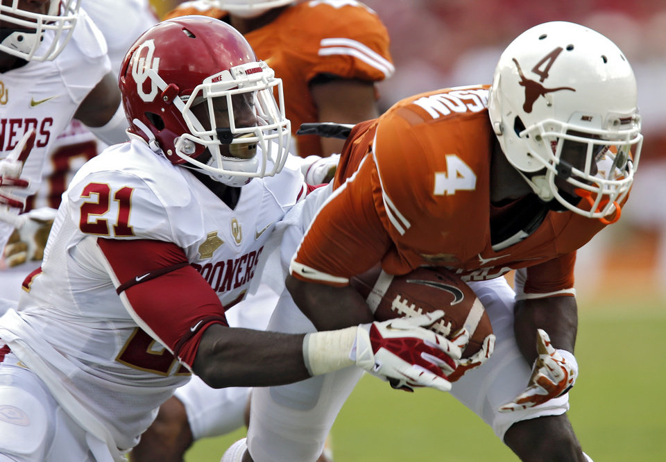 Photo - OU's Keith Ford (21) stops UT's Daje Johnson (4) on a kick return during the Red River Rivalry college football game between the University of Oklahoma Sooners (OU) and the University of Texas Longhorns (UT) at the Cotton Bowl Stadium in Dallas, Saturday, Oct. 12, 2013. Photo by Chris Landsberger, The Oklahoman