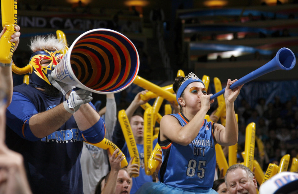 Photo - Fans cheer during the NBA basketball game between Oklahoma City and Miami at the OKC Arena in Oklahoma City, Thursday, Jan. 30, 2011. Photo by Sarah Phipps, The Oklahoman