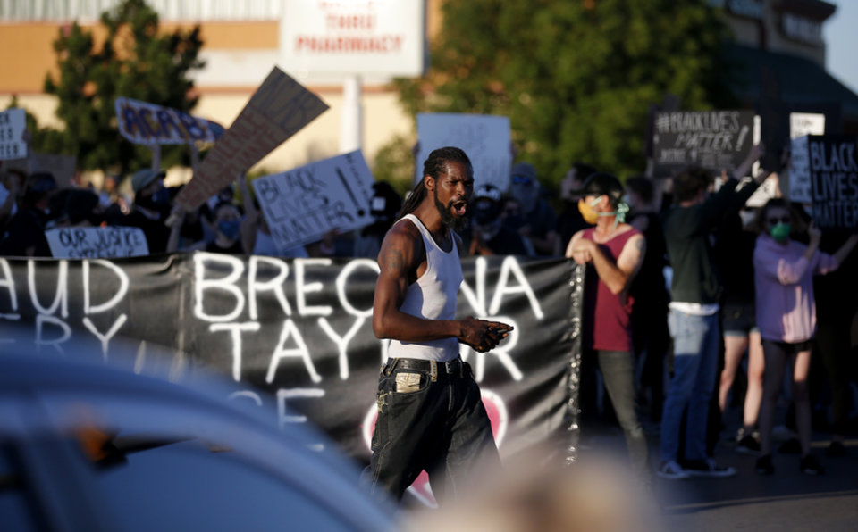 Photo - Protesters block the intersection of 23rd and Classen in Oklahoma City, Saturday, May 30, 2020. The protest was in response to the death of George Floyd. [Sarah Phipps/The Oklahoman]