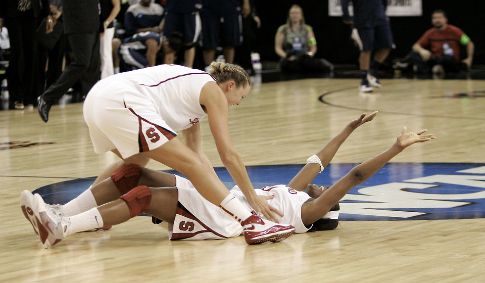 Stanford's Jayne Appel, left, runs out to Nnemkadi Ogwumike after Stanford beat Xavier 55-53 on a shot at the buzzer on Monday to help the Cardinal advance to the Final Four. Ogwumike leads the team in scoring and rebounds while Appel is the heart and soul of the team. AP Photo