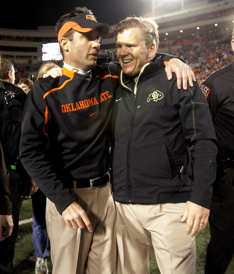 Photo - OSU coach Mike Gundy and Colorado coach Dan Hawkins talk after the game. Photo by Bryan Terry, The Oklahoman
