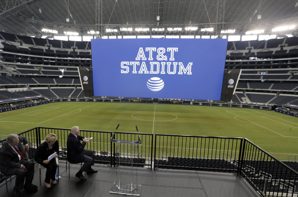Photo - The new name of Dallas Cowboys stadium is unveiled during a news conference announcing the new AT&T Stadium Thursday, July 25, 2013, in Arlington, Texas. The terms of the naming deal were not released.  (AP Photo/LM Otero)