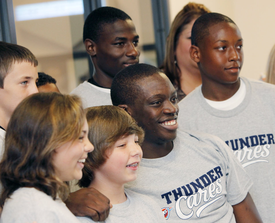 Photo - Oklahoma City Thunder draft pick Reggie Jackson, third from left on the bottom row, poses with kids from the Boys and Girls Club of Oklahoma County in Oklahoma City, Saturday, June 25, 2011. The Thunder selected Reggie Jackson with the 24th pick in this year's NBA draft. Photo by Nate Billings, The Oklahoman