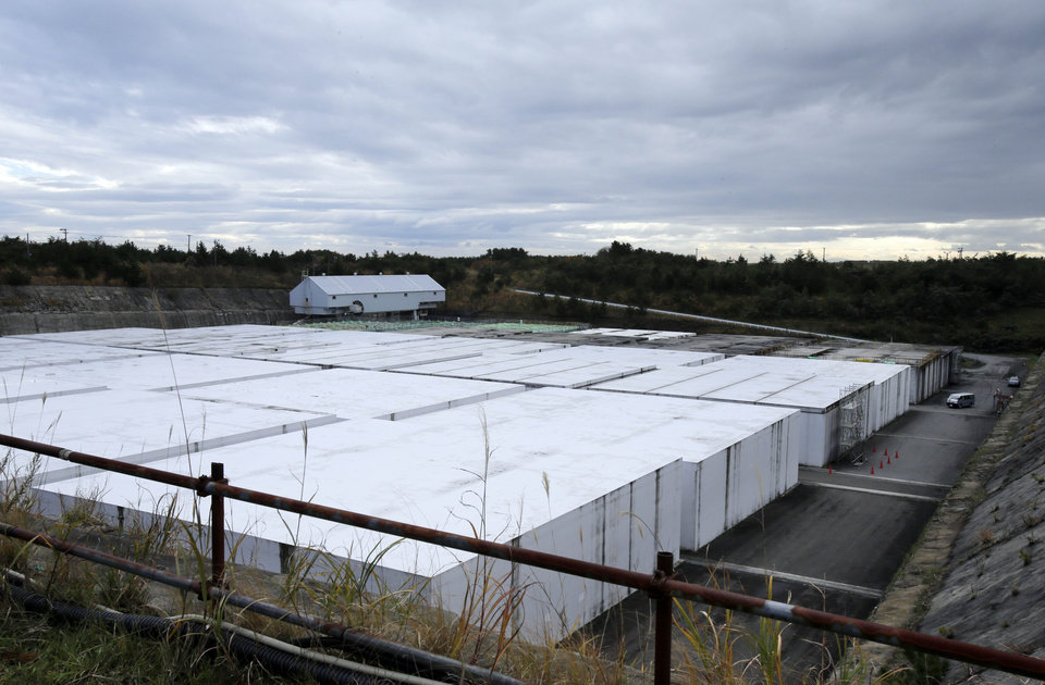 This Nov. 8, 2012 photo shows the low-level radioactive waste disposal center, a part of the Rokkasho spent nuclear fuel reprocessing plant facilities, run by Japan Nuclear Fuel Ltd., in Rokkasho village in Aomori Prefecture, northern Japan. By hosting a high-tech facility that would convert spent fuel into a plutonium-uranium mix designed for the next generation of reactors, Rokkasho was supposed to provide fuel while minimizing nuclear waste storage problems. Those ambitions are falling apart because years of attempts to build a �fast breeder� reactor, which would use the reprocessed fuel, appear to be ending in failure.  (AP Photo/Koji Sasahara)