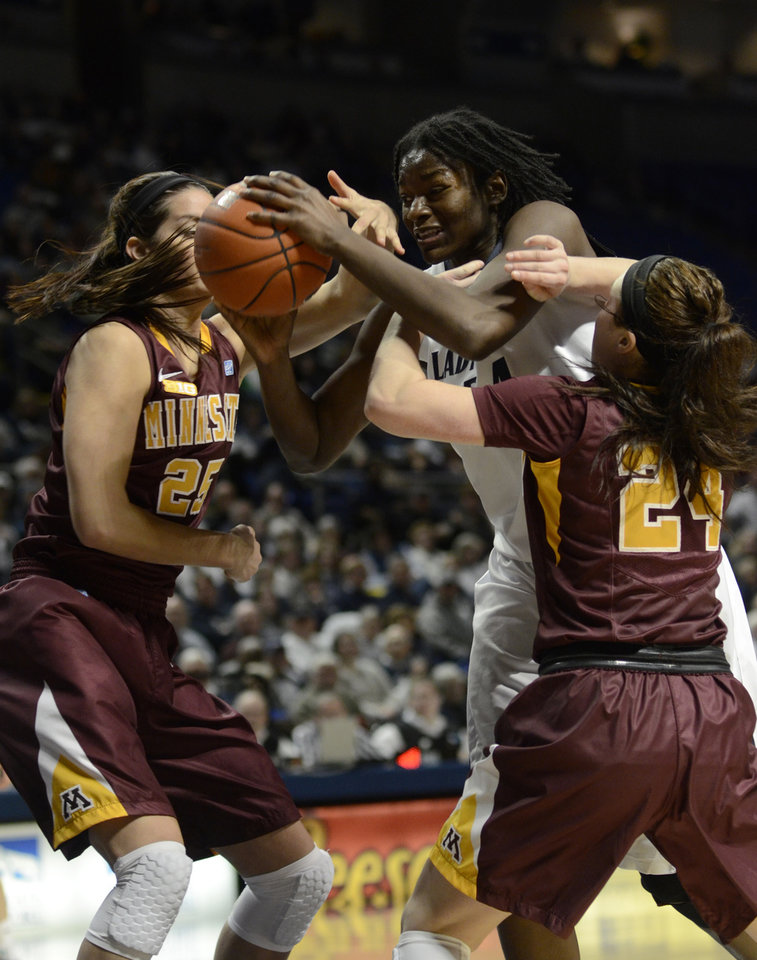 Penn State's Nikki Greene (54) looks for room under the basket around Minnesota's Katie Loberg (25) and Mikayla Bailey (24) during the first half of an NCAA college basketball game in State College, Pa., Thursday, Jan. 24, 2013. (AP Photo/Ralph Wilson)