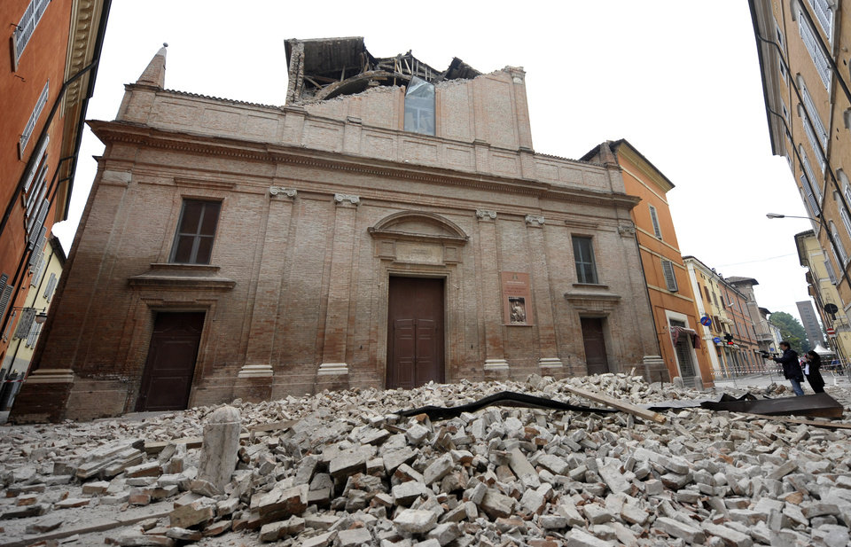 Photo -   Debris of a collapsed church block a road in Finale Emilia, some 60 kilometers east of Bologna in northern Italy after the region was hit a quake early Sunday, May 20, 2012. One of the strongest earthquakes to shake northern Italy rattled the region around Bologna early Sunday, a magnitude-6.0 temblor that killed at least four people, toppled buildings and sent residents running into the streets, emergency services and news reports said.(AP Photo/Marco Vasini)