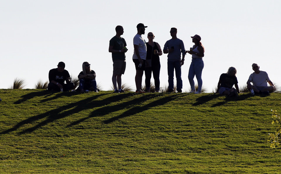 Photo - People wait on the hill for the concert to start during the grand opening of Scissortail Park in Oklahoma City, Friday, Sept. 27, 2019. [Nate Billings/The Oklahoman]