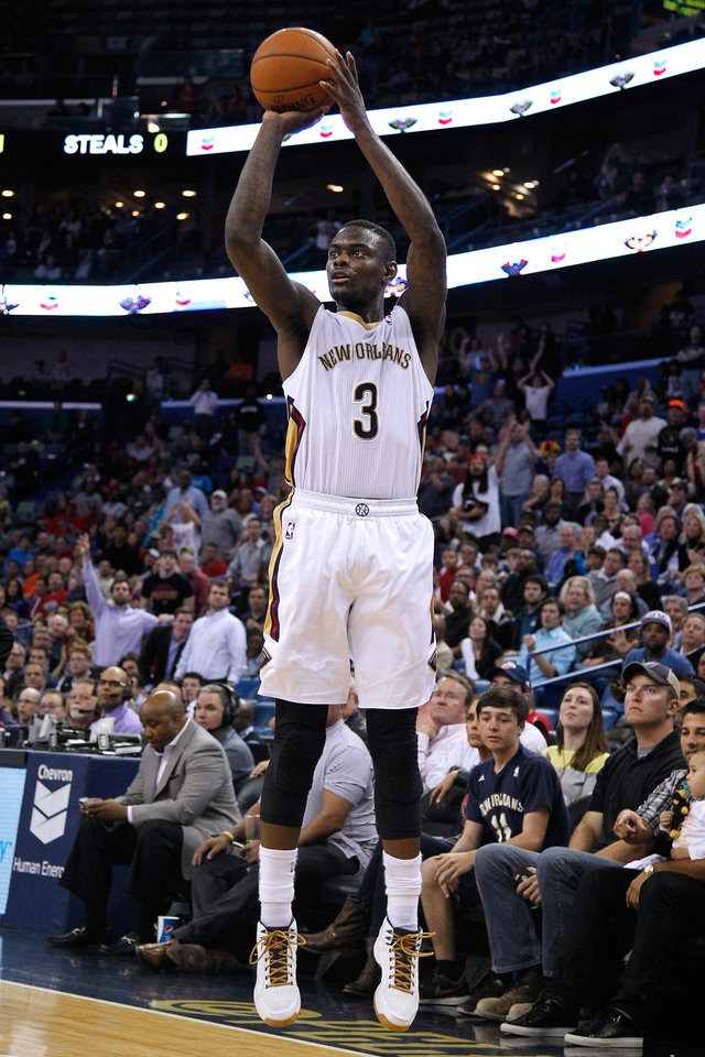Photo - New Orleans Pelicans guard Anthony Morrow (3) shoots the ball during overtime of an NBA basketball game against the Brooklyn Nets in New Orleans, Monday, March 24, 2014. The Pelicans won 109-104. (AP Photo/Jonathan Bachman)