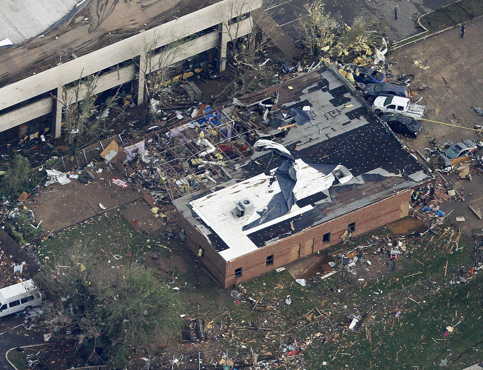 Photo - Agapeland Learning Center destroyed by the tornado in Moore, Monday May 20, 2013. Photo By Steve Gooch, The Oklahoman