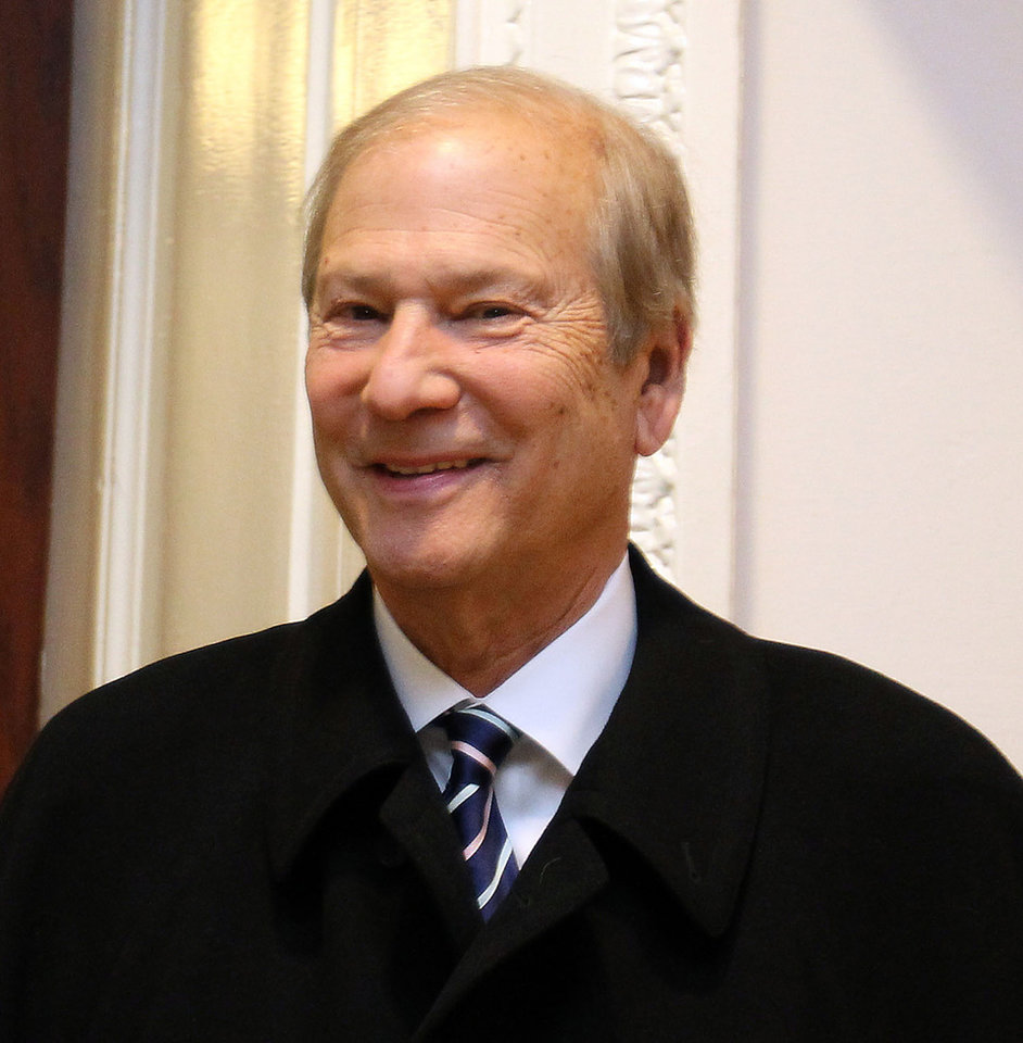 Photo - File- This Nov. 20, 2013, file photo shows Interstate General Media minority owner Lewis Katz smiling as he leaves the court room inside City Hall in Philadelphia. Katz, a self-made man who built his fortune in New York parking lots, billboards and cable TV, and went on to buy the NBA's New Jersey Nets, NHL's New Jersey Devils and The Philadelphia Inquirer, died in a weekend plane crash. He was 72. (AP Photo/Philadelphia Daily News, David Maialetti)