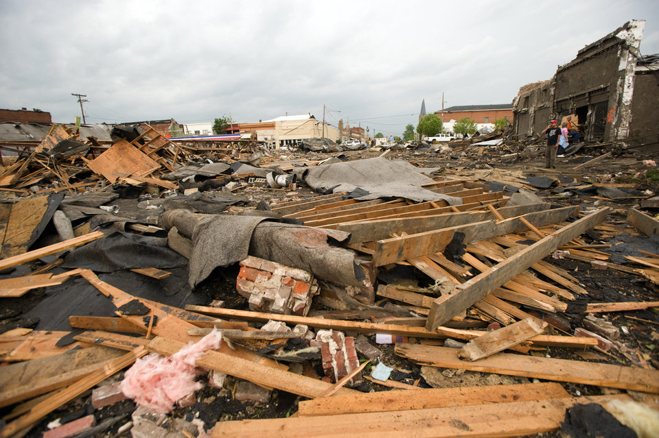 Photo - Destruction lines a street in downtown Cullman, Ala. after a tornado touched down on Wednesday afternoon, April 27, 2011. (AP Photo/Decatur Daily, Brennen Smith)