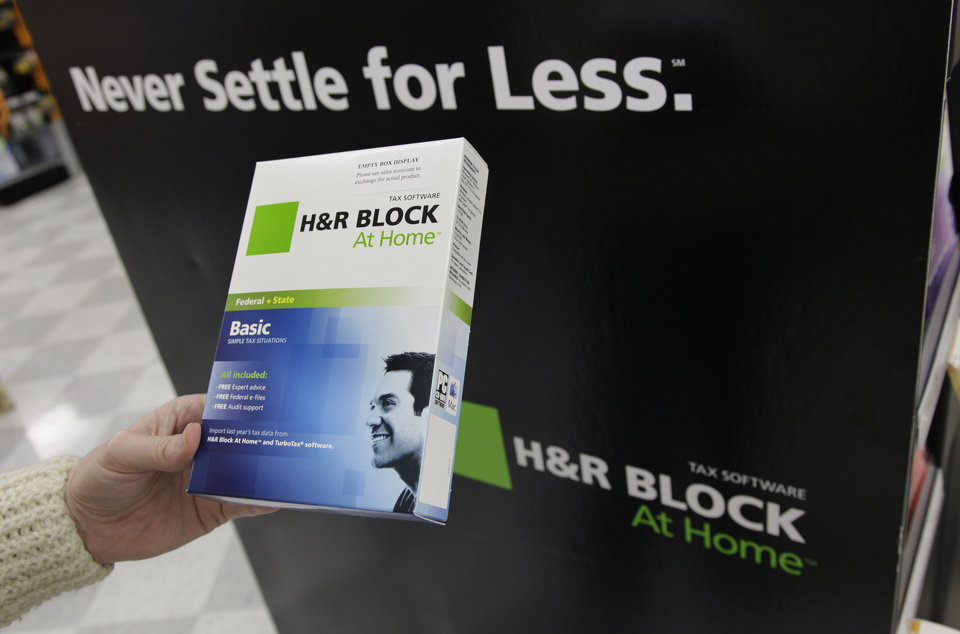 This Jan. 24, 2012 photo, shows Andrea Lucas poses with H&R Block tax software at OfficeMax in Mountain View, Calif. H&R Block\'s fiscal second-quarter loss narrowed, helped by cost-cutting efforts, the company said Thursday, Dec. 6, 2012. Revenue climbed mostly because of a strong tax season in Australia. The nation\'s largest tax preparation company typically turns in a loss in the August-to-October period because it takes in most of its revenue during the U.S. tax season. (AP Photo/Paul Sakuma)