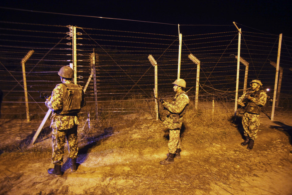 Photo - Indian Border Security Force (BSF) soldiers stand guard during a night patrol near international border fencing at Suchet Garh in Ranbir Singh Pura, about 27 kilometers (17 miles) south of Jammu, India, Thursday, Jan. 10, 2013. The Pakistani army accused Indian troops of firing across the disputed Kashmir border and killing a soldier Thursday, the third deadly incident in the disputed Himalayan region in recent days. (AP Photo/Channi Anand)