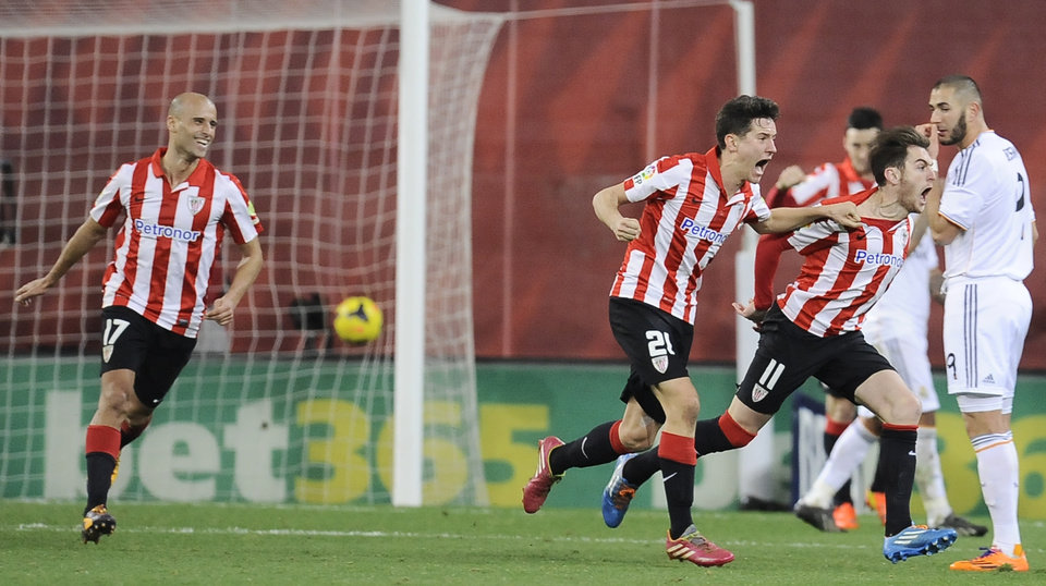 Photo - Athletic Bilbao's Ibai Gomez, second right,  celebrates between his teammates Mikel Rico, left, and Ander Herrera, center,  after scoring his goal resulting in a tie, during the Spanish League soccer match between Athletic Bilbao and Real Madrid, at San Mames stadium in Bilbao, Spain, Sunday, Feb. 2, 2014. (AP Photo/Alvaro Barrientos)