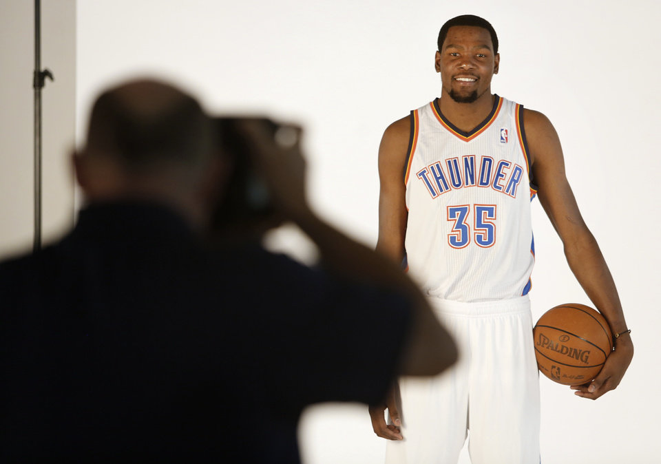Photo - Kevin Durant poses for photos during media day with the Oklahoma City Thunder in Oklahoma City, Thursday September  27, 2013. Photo By Steve Gooch, The Oklahoman