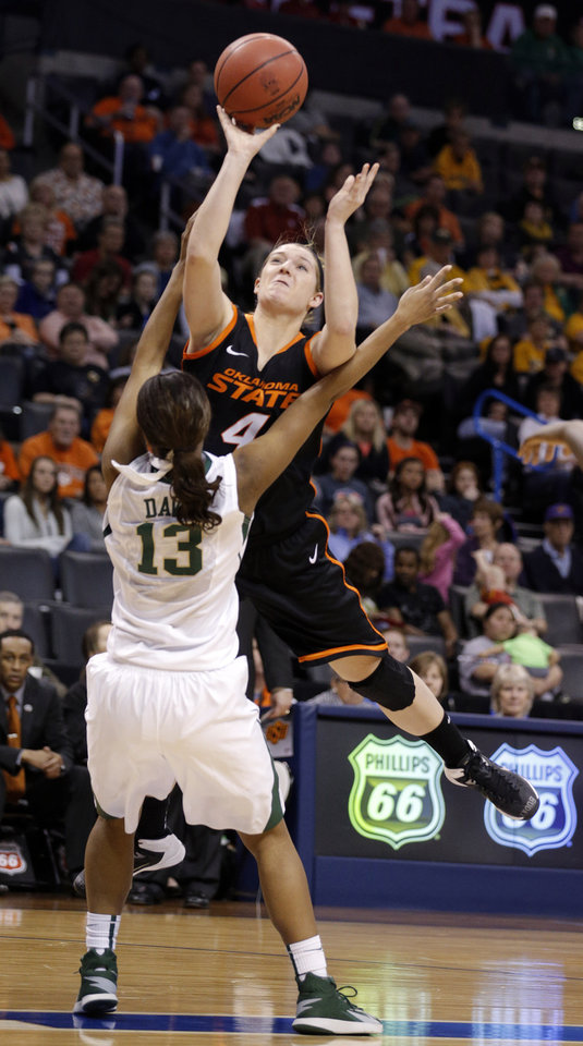 Photo - Oklahoma State's Liz Donohoe (4) shoots as Baylor's Nina Davis (13) defends during the Women's Big 12 basketball tournament game between Baylor and Oklahoma State at Chesapeake Energy Arena  in Oklahoma City, Okla., Sunday, March 9, 2014. Photo by Sarah Phipps, The Oklahoman