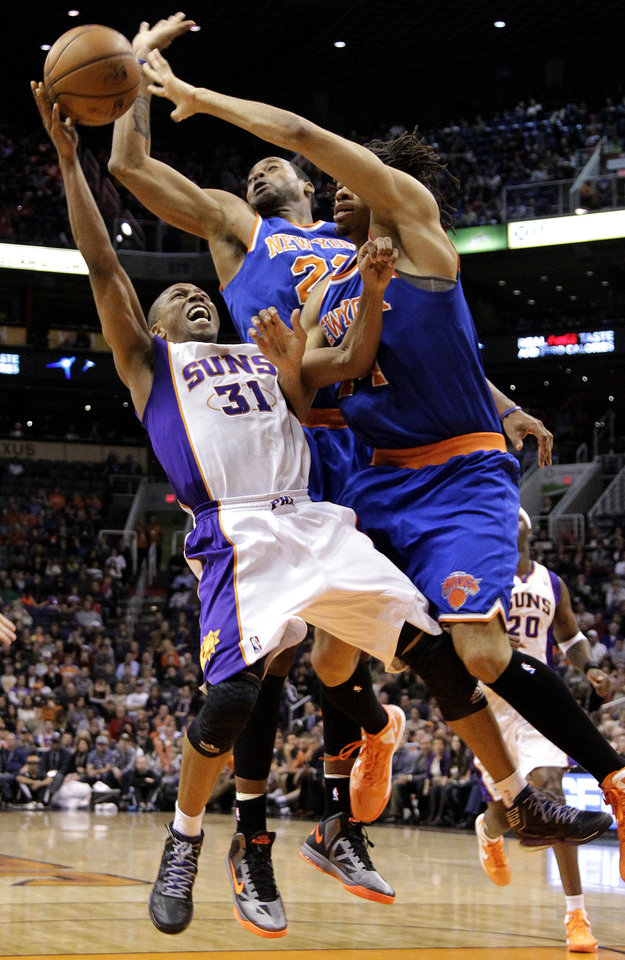 New York Knicks' Marcus Camby, rear, and Chris Copeland defend against Phoenix Suns' Sebastian Telfair (31) during the second half of an NBA basketball game, Wednesday, Dec. 26, 2012, in Phoenix. The Knicks won 99-97. (AP Photo/Matt York)