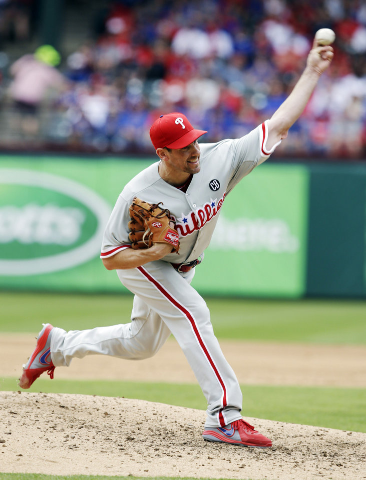 Photo - Philadelphia Phillies starting pitcher Cliff Lee delivers the ball during the third inning of an opening day baseball game against the Texas Rangers at Globe Life Park, Monday, March 31, 2014, in Arlington, Texas.  (AP Photo/Tony Gutierrez)
