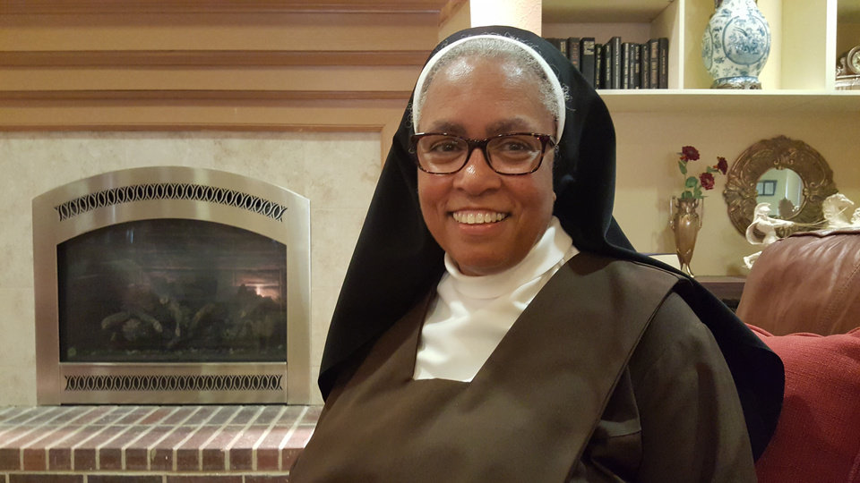 Photo - Sister Veronica Higgins poses for a photo in the lobby of St. Ann's Retirement Center in northwest Oklahoma City. [Photo by Carla Hinton, The Oklahoman]