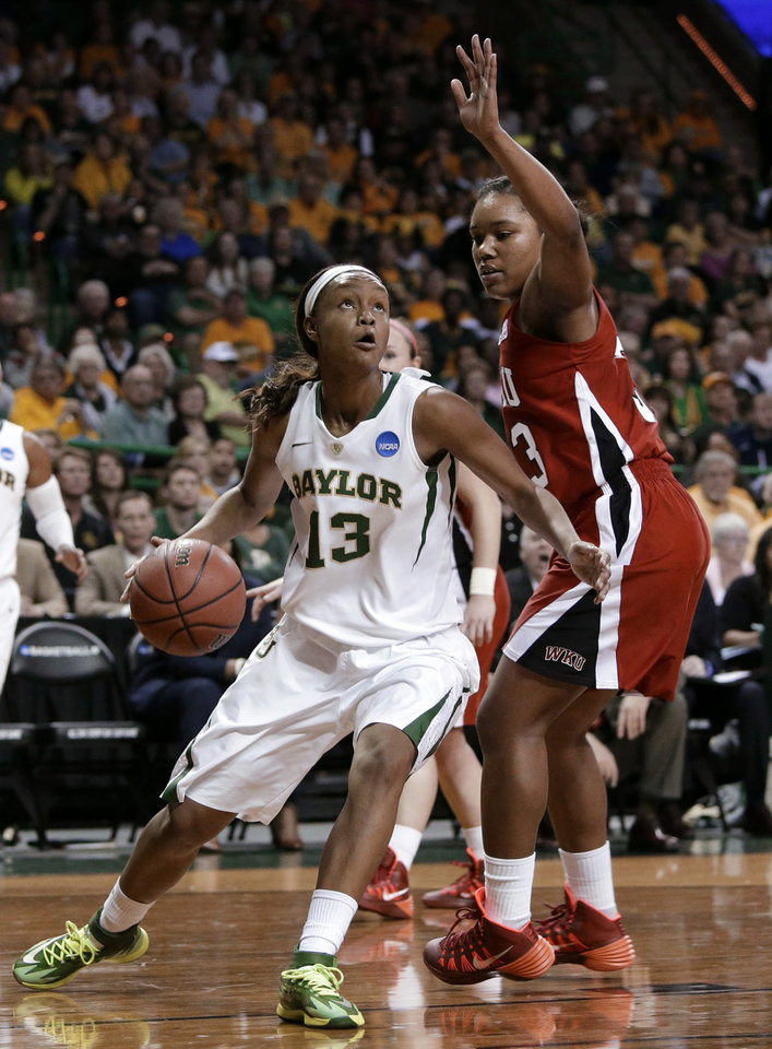Photo - Baylor's Nina Davis (13) gets by Western Kentucky's Jalynn McClain (33) on a drive to the basket in the second half of a first-round game in the NCAA women's college basketball tournament, Saturday, March 22, 2014, in Waco, Texas. Davis had a game-high 32 points with 10 rebounds in the 87-74 Baylor win. (AP Photo/Tony Gutierrez)