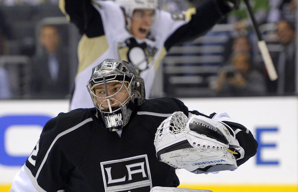 Photo - Pittsburgh Penguins center Sidney Crosby, top, celebrates a goal by left wing Jussi Jokinen, of Finland, on Los Angeles Kings goalie Jonathan Quick during the first period of an NHL hockey game, Thursday, Jan. 30, 2014, in Los Angeles. (AP Photo)