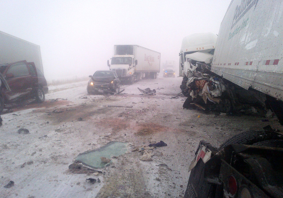 This photo provided by the Iowa State Patrol shows the scene of a 25-vehicle pileup that killed three people Thursday, Dec. 20, 2012 north of Des Moines, Iowa.  Authorities said drivers were blinded by blowing snow and didn�t see vehicles that had slowed or stopped on Interstate 80 about 60 miles north of Des Moines. A chain reaction of crashes involving semitrailers and passenger cars closed down a section of the highway. (AP Photo/Iowa State Patrol)