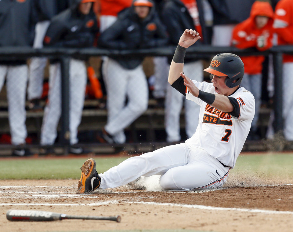 Photo - OSU's Max Hewitt (7) scores in the third inning during a college baseball game between the University of Texas Rio Grande Valley Vaqueros and the Oklahoma State Cowboys, the OSU home opener, at Allie P. Reynolds Stadium in Stillwater, Okla., Friday, Feb. 21, 2020. [Nate Billings/The Oklahoman]