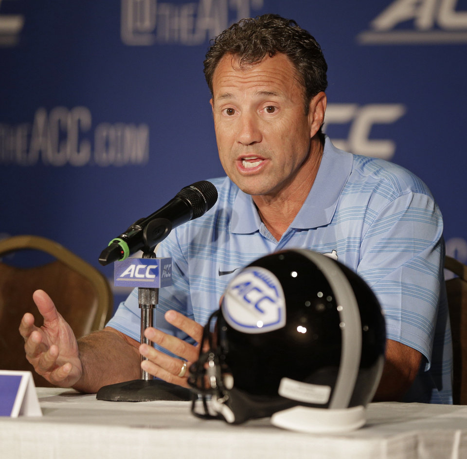 Photo - North Carolina head coach Larry Fedora answers a question during a news conference at the Atlantic Coast Conference Football kickoff in Greensboro, N.C., Monday, July 21, 2014. (AP Photo/Chuck Burton)