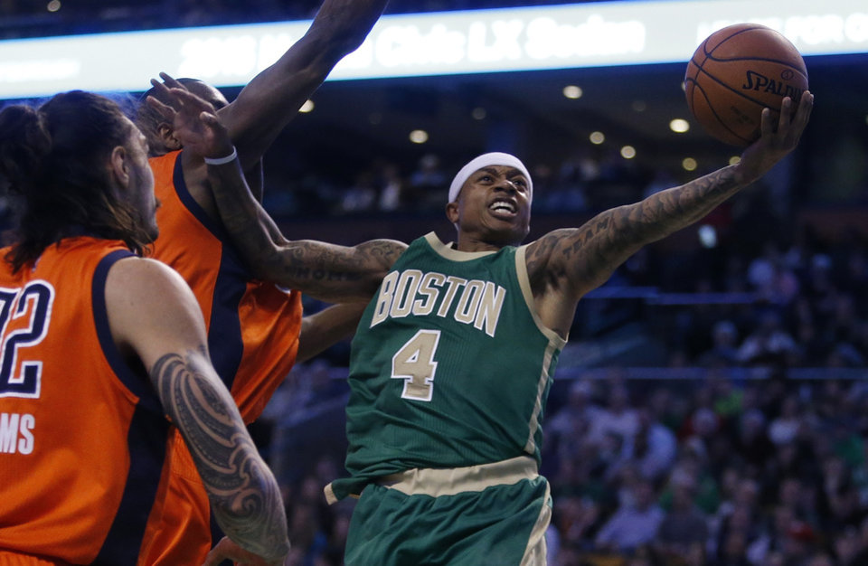 Photo - Boston Celtics' Isaiah Thomas (4) goes up to shoot in front of Oklahoma City Thunder's Steven Adams, left, during the second quarter of an NBA basketball game in Boston, Wednesday, March 16, 2016. The Thunder won 130-109. (AP Photo/Michael Dwyer)