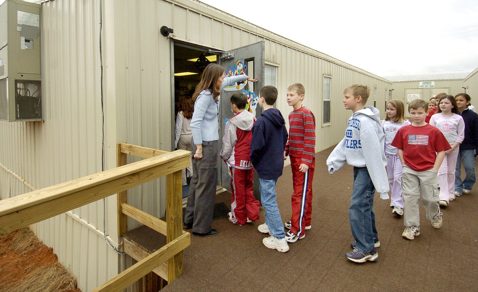 Edmond, Okla. 1/27/05 Students are greeted by principal Michelle Anderson as they file into a portable building at the Prairie Vale Elementary School in the Deer Creek School District. The district has the most enrollment growth in the state this year. By Paul Hellstern/The Oklahoman