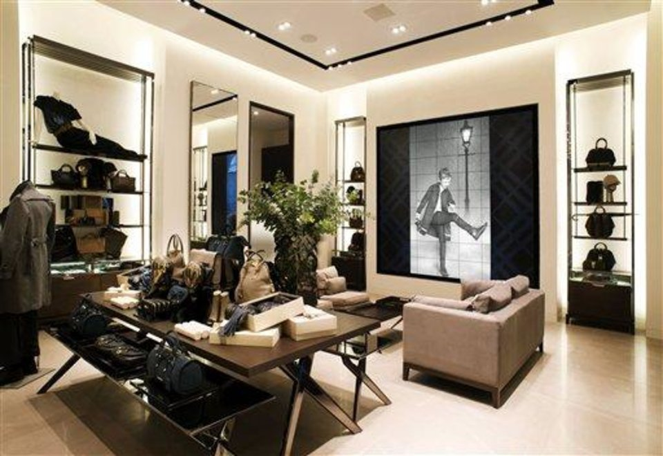 Photo - This undated publicity photo provided by BURBERRY shows an interior view of the new BURBERRY Flagship store opened in November 2012 on Michigan Avenue in Chicago. BURBERRY is interacting directly with consumers in the digital sphere too, launching projects like artofthetrench.com. The website invites users to upload pictures of themselves wearing BURBERRY trench coats.  (AP Photo/BURBERRY)