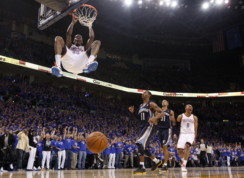 Oklahoma City\'s Kevin Durant (35) dunks the ball as Russell Westbrook (0) celebrates near Mike Conley (11) and Shane Battier (31) of Memphis in the fourth quarter during game 7 of the NBA basketball Western Conference semifinals between the Memphis Grizzlies and the Oklahoma City Thunder at the OKC Arena in Oklahoma City, Sunday, May 15, 2011. Photo by Sarah Phipps, The Oklahoman