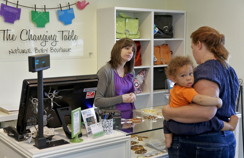 The Changing Table owner Kristina Amiraslani helps a customer at the baby boutique located at 1145 W I-240 Service Road on Tuesday, April 16, 2013, in Oklahoma City, Okla. The store offers locally made and eco friendly items.  Photo by Chris Landsberger, The Oklahoman