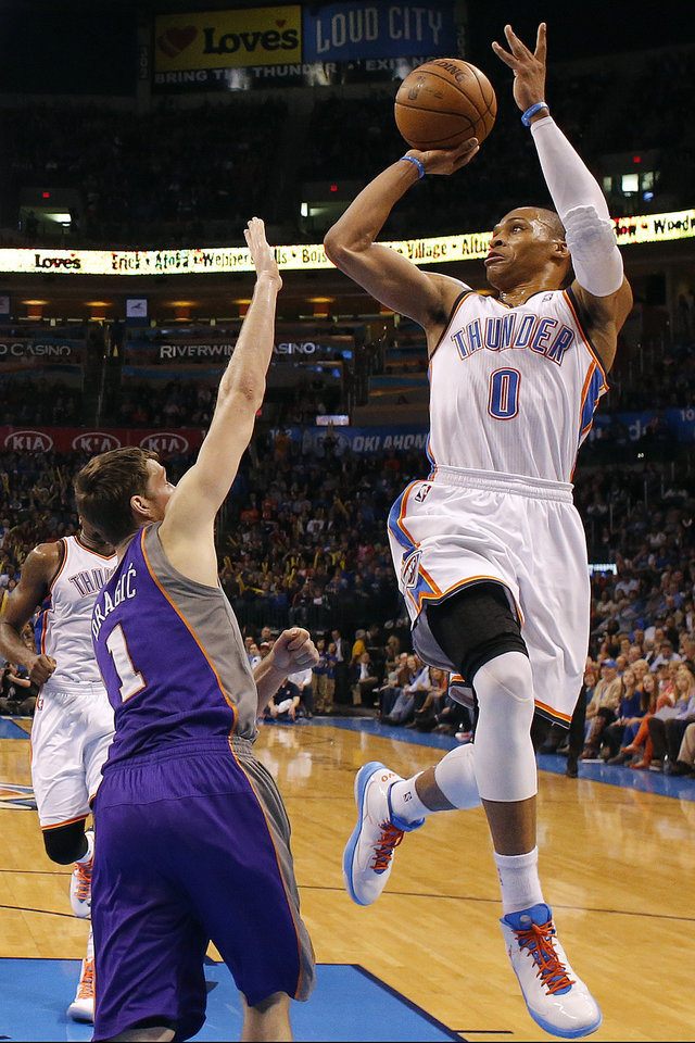 Oklahoma City's' Russell Westbrook (0) shoots over Phoenix 's Goran Dragic (1) during the NBA game between the Oklahoma City Thunder and the Phoenix Suns at theChesapeake Energy Arena, Friday, Feb. 8, 2013.Photo by Sarah Phipps, The Oklahoman