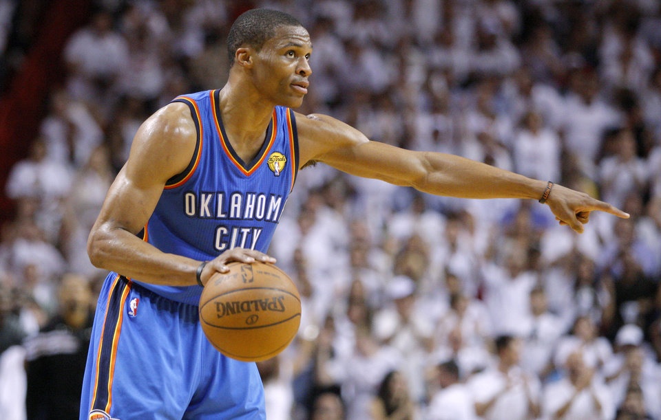 Photo - NBA BASKETBALL: Oklahoma City's Russell Westbrook (0) gives directions to teammates during Game 4 of the NBA Finals between the Oklahoma City Thunder and the Miami Heat at American Airlines Arena, Tuesday, June 19, 2012. Photo by Bryan Terry, The Oklahoman