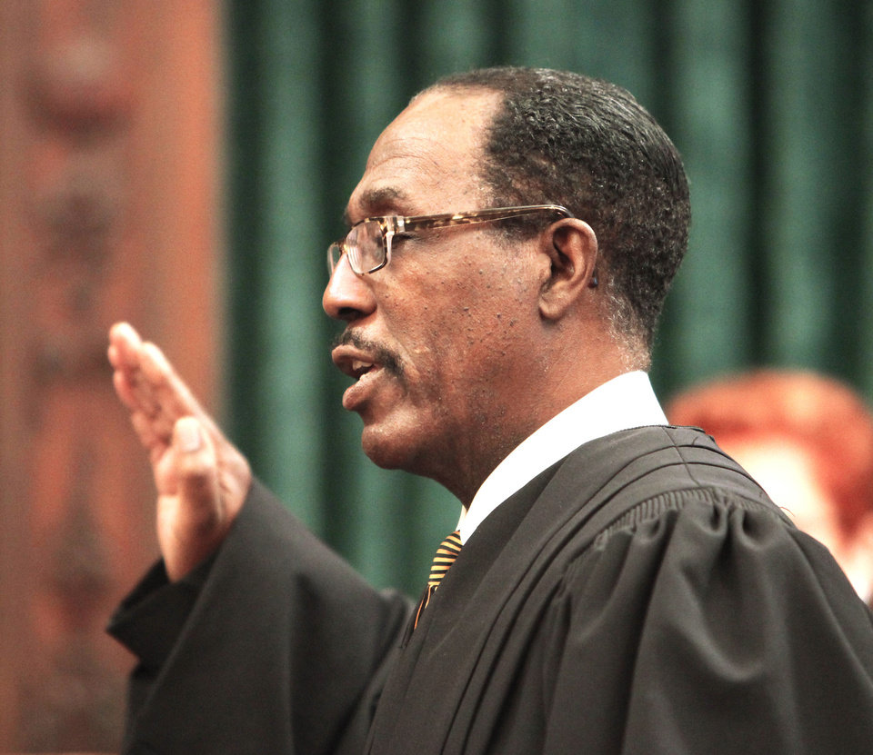 Photo - Tom Colbert takes the oath of office Friday as the first black chief justice of the Oklahoma Supreme Court.  Photo by David McDaniel, The Oklahoman