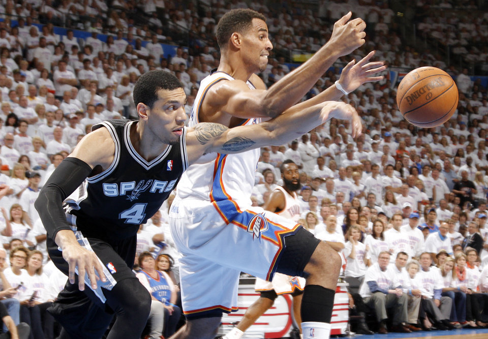 Thabo Sefolosha (2) battles for the ball with Danny Green (4) during Game 6 of the Western Conference Finals between the Oklahoma City Thunder and the San Antonio Spurs in the NBA playoffs at the Chesapeake Energy Arena in Oklahoma City, Wednesday, June 6, 2012. Photo by Chris Landsberger, The Oklahoman