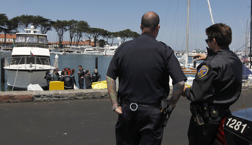 Photo - Police officers protect the scene where attempts to revive sailor Andrew Simpson, of Great Britain, were unsuccessful, Thursday, May 9, 2013, in San Francisco, Calif. Simpson died after the Artemis Racing AC72 catamaran, an America's Cup entry from Sweden, capsized during training in San Francisco Bay, the team said.  (AP Photo/San Francisco Chronicle, Paul Chinn) EXAMINER OUT. MAGS OUT; NO SALES, NORTHERN CALIFORNIA NEWSERPAPERS MANDATORY CREDIT