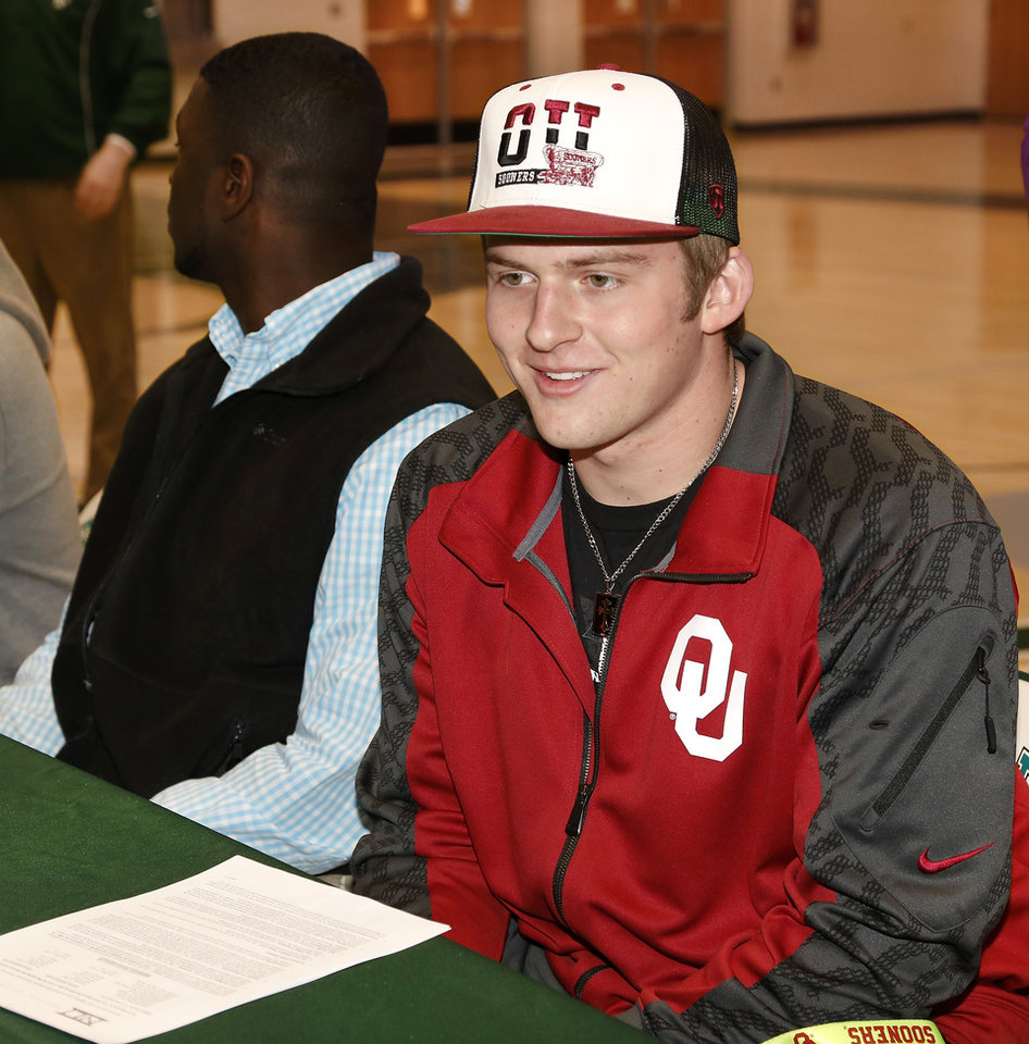 Photo - Justice Hansen is an Edmond Santa Fe quarterback who signed a letter of intent to play football with OU during signing day ceremony in the gymnasium at Edmond Santa Fe High School on Wednesday, Feb. 5, 2014.   Photo by Jim Beckel, The Oklahoman