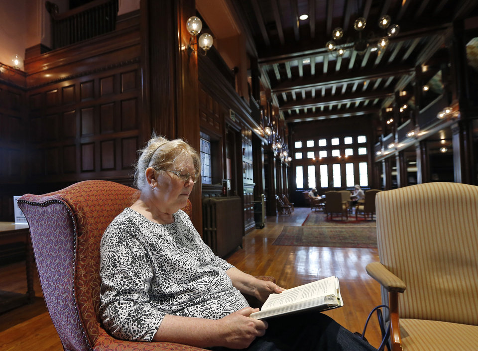 Photo -  Susan McNamara relaxes with a book at her favorite place at the public library in Quincy, Mass.  AP Photo   Elise Amendola -  AP