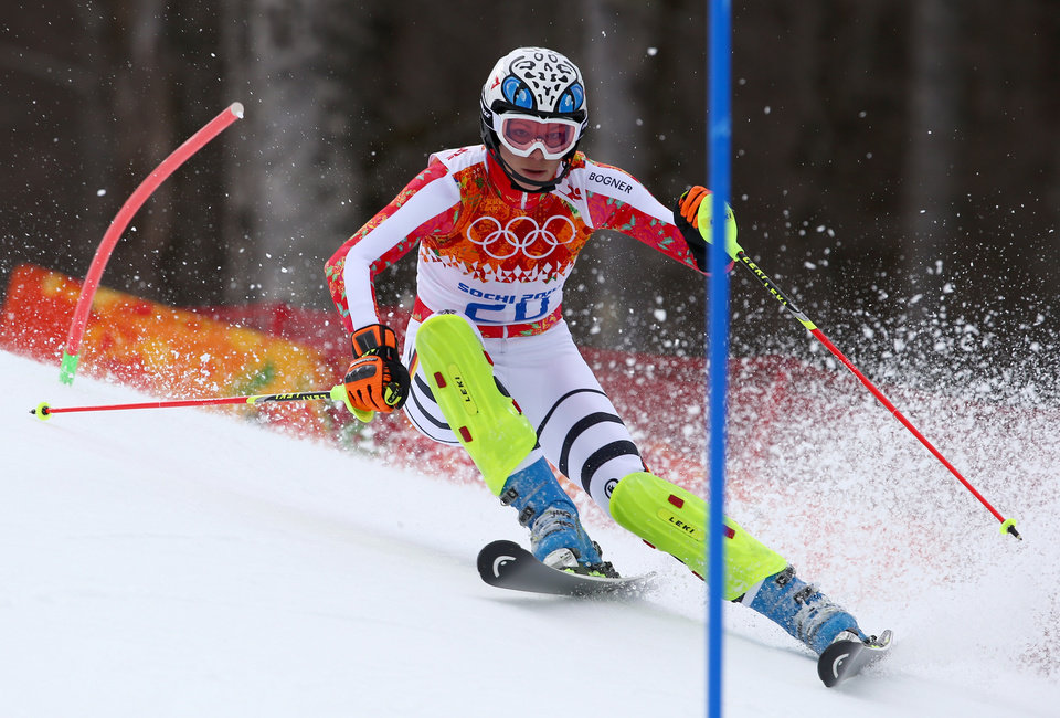 Photo - Germany's Maria Hoefl-Riesch passes a gate in the slalom portion of the women's supercombined to win the gold medal in the Sochi 2014 Winter Olympics, Monday, Feb. 10, 2014, in Krasnaya Polyana, Russia.(AP Photo/Alessandro Trovati)
