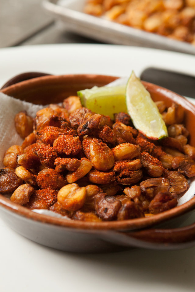 Popcorn is a centuries-old simple food that has gone gourmet. Though technicallly not popcorn, dried hominy is soaked, fried and sprinked with chili-spice. (Renne Brock/Atlanta Journal-Constitution/MCT)