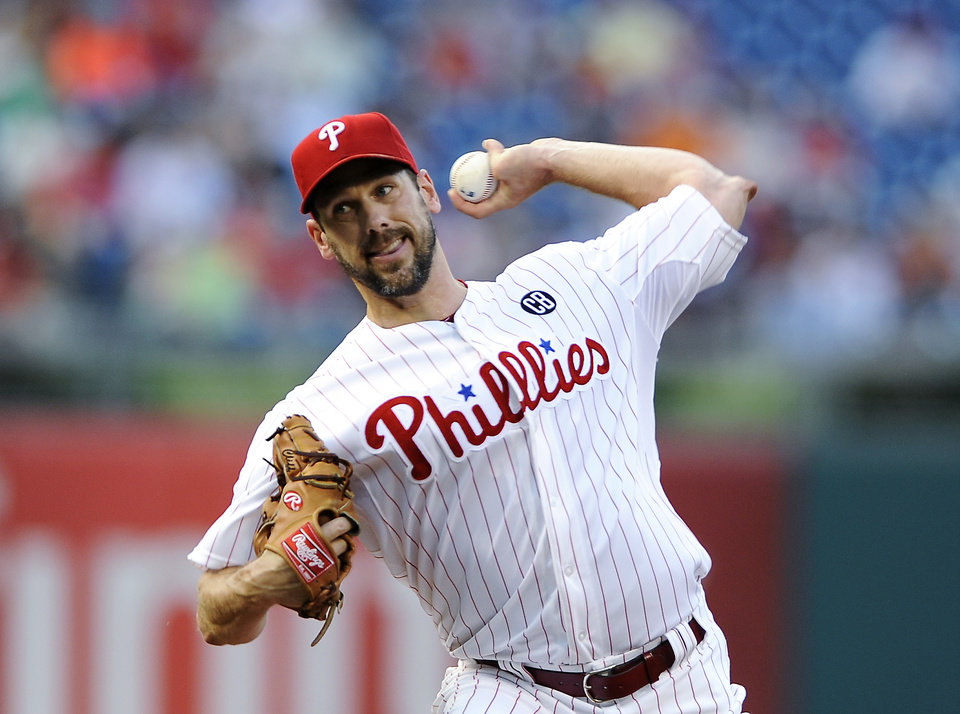 Photo - Philadelphia Phillies starting pitcher Cliff Lee throws a pitch during the first inning of a baseball game against the San Francisco Giants on Monday, July 21, 2014, in Philadelphia. (AP Photo/Michael Perez)