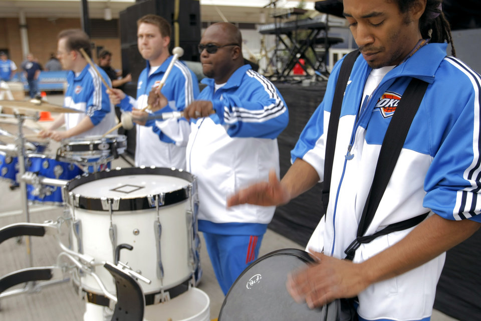 Photo - Babac Saiedi plays the drums for fans before the first round NBA basketball playoff game between the Oklahoma City Thunder and the Denver Nuggets on Wednesday, April 20, 2011, at the Oklahoma City Arena. Photo by Sarah Phipps, The Oklahoman