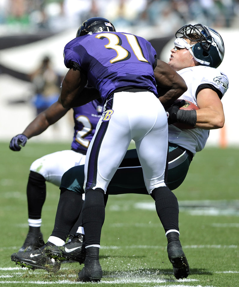 FILE - In this Sept. 16, 2012, file photo, Philadelphia Eagles tight end Brent Celek, right, is tackled by Baltimore Ravens strong safety Bernard Pollard during the first half of an NFL football game in Philadelphia. Pollard likes to talk and loves to hit. The hard-tackling safety used the latter talent to push the Baltimore Ravens past New England and into the Super Bowl. (AP Photo/Michael Perez, File)