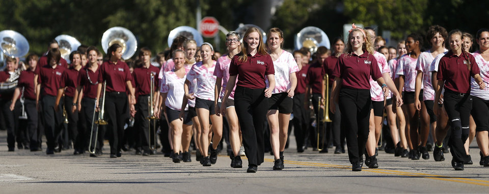 Photo - Edmond Memorial High School's band marches in the homecoming parade in downtown Edmond. PHOTO BY BRYAN TERRY, THE OKLAHOMAN.  Bryan Terry - THE OKLAHOMAN